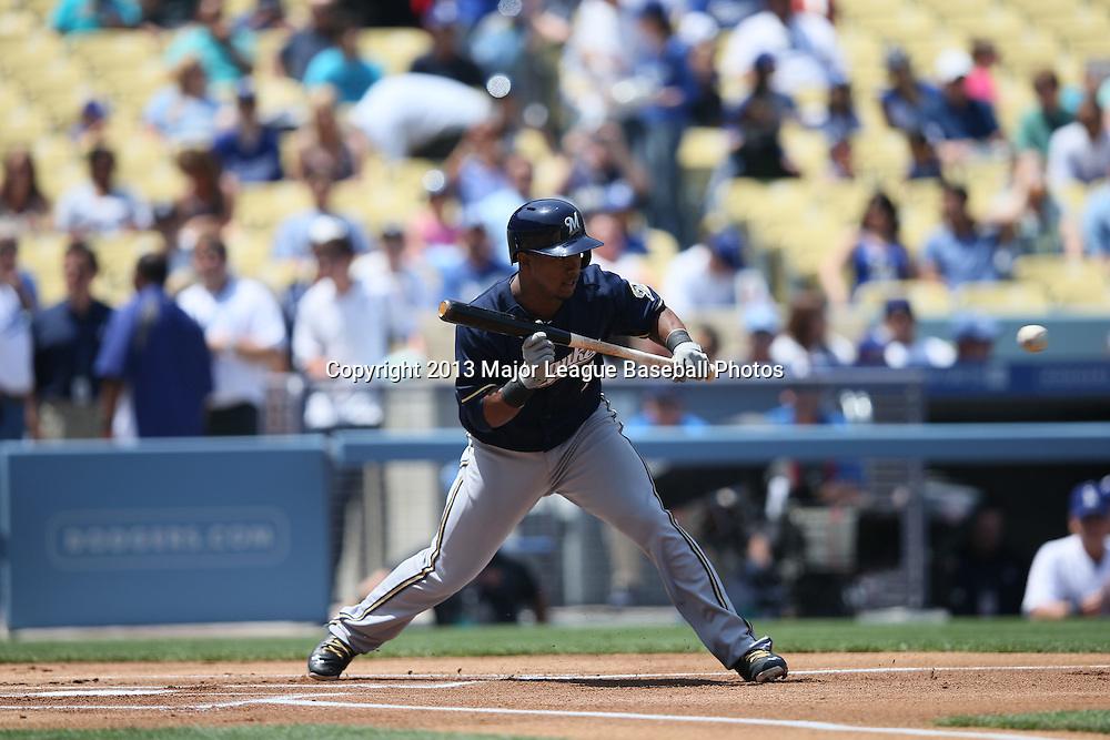 LOS ANGELES, CA - APRIL 28:  Jean Segura #9 of the Milwaukee Brewers attempts a bunt during the game against the Los Angeles Dodgers on Sunday, April 28, 2013 at Dodger Stadium in Los Angeles, California. The Dodgers won the game 2-0. (Photo by Paul Spinelli/MLB Photos via Getty Images) *** Local Caption *** Jean Segura
