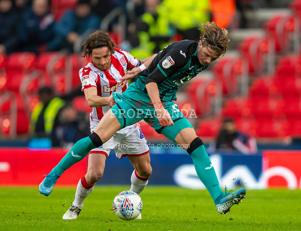 STOKE-ON-TRENT, ENGLAND - Saturday, January 25, 2020: Stoke City's captain Joe Allen (L) challenges Swansea City's Conor Gallagher during the Football League Championship match between Stoke City FC and Swansea City FC at the Britannia Stadium. (Pic by David Rawcliffe/Propaganda)