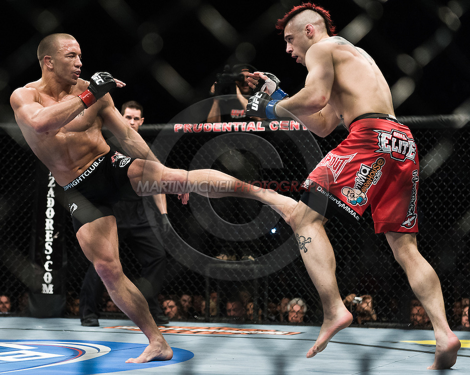 """NEWARK, NEW JERSEY, MARCH 27, 2010: Georges St. Pierre (left) and Dan Hardy are pictured during their bout at """"UFC 111: St. Pierre vs. Hardy"""" in the Prudential Center, New Jersey on March 27, 2010"""