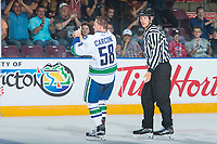 PENTICTON, CANADA - SEPTEMBER 8: Michael Carcone #58 of Vancouver Canucks heads to the penalty box after dropping the gloves with a player of the Winnipeg Jets on September 8, 2017 at the South Okanagan Event Centre in Penticton, British Columbia, Canada.  (Photo by Marissa Baecker/Shoot the Breeze)  *** Local Caption ***