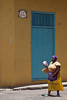 Peanut seller in Old Havana sings as she wanders the streets.