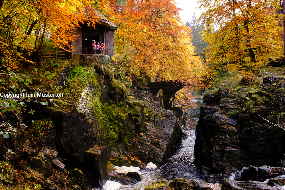 Spectacular autumn colours at The Hermitage a famous beauty spot near Dunkeld in Perthshire. Pictured is Ossian's Hall overlooking the River Braan.