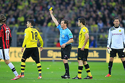 15.02.2014, Signal Iduna Park, Dortmund, GER, 1. FBL, Borussia Dortmund vs Eintracht Frankfurt, 21. Runde, im Bild Nuri Sahin (Borussia Dortmund #18) bekommt die gelbe Karte von Schiedsrichter Peter Sippel (Muenchen) wegen Meckerns mit Sokratis (Borussia Dortmund #25) // during the German Bundesliga 21th round match between Borussia Dortmund and Eintracht Frankfurt at the Signal Iduna Park in Dortmund, Germany on 2014/02/15. EXPA Pictures © 2014, PhotoCredit: EXPA/ Eibner-Pressefoto/ Schueler<br /> <br /> *****ATTENTION - OUT of GER*****