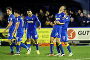 AFC Wimbledon defender Paul Robinson (6) celebrating after scoring 1-1 during the EFL Sky Bet League 1 match between AFC Wimbledon and Coventry City at the Cherry Red Records Stadium, Kingston, England on 14 February 2017. Photo by Matthew Redman.