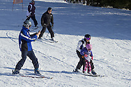 Warwick, New York - People ski  at Mount Peter Ski and Ride on Feb. 10, 2013. The man at left is recording video on his smartphone. ©Tom Bushey / The Image Works