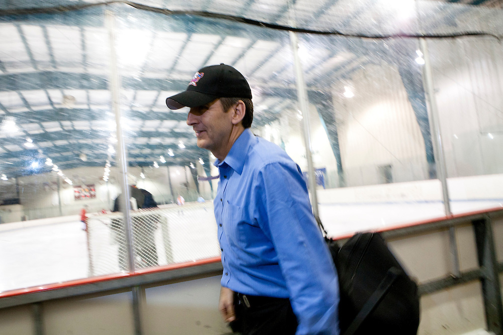 Republican presidential hopeful Tim Pawlenty arrives to play in a scrimmage hockey game during a campaign stop on Friday, July 22, 2011 in Urbandale, IA.