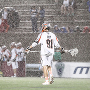 Dillon Roy #91 of the Denver Outlaws is seen in the rain during the game at Harvard Stadium on May 10, 2014 in Boston, Massachusetts. (Photo by Elan Kawesch)