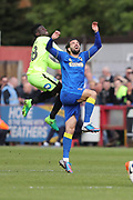 Peterborough United midfielder Leo Da-Silva-Lopes (18) and AFC Wimbledon defender George Francomb (7) during the EFL Sky Bet League 1 match between AFC Wimbledon and Peterborough United at the Cherry Red Records Stadium, Kingston, England on 17 April 2017. Photo by Stuart Butcher.