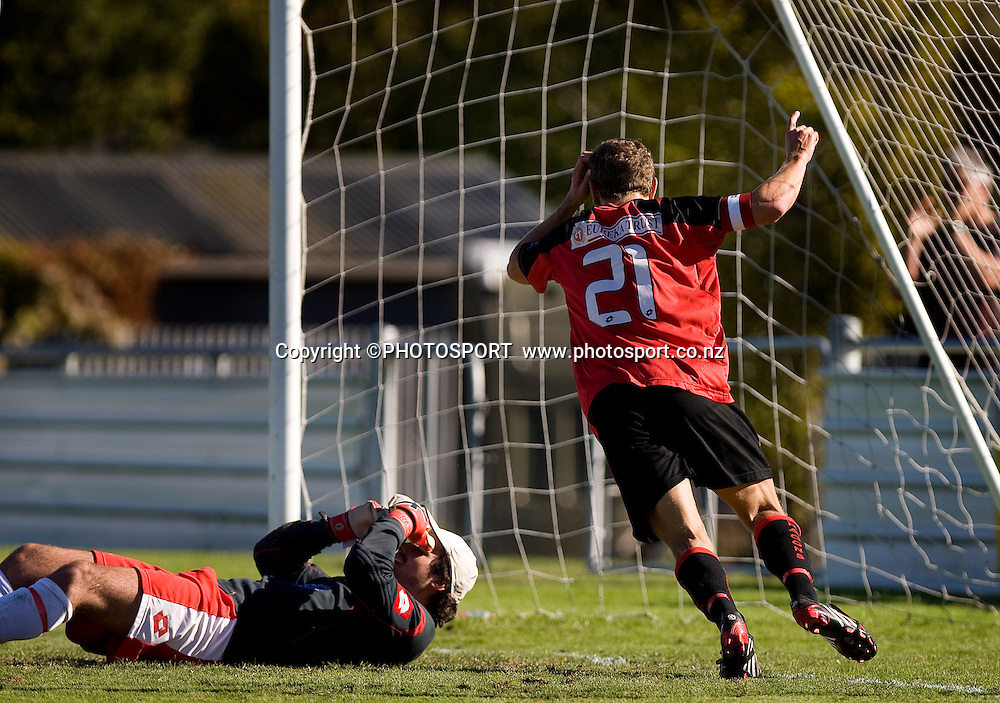 Canterbury United captain Ben Harris celebrates the goal by Sam Miles with Waitakere goal keeper Sam Hannah on the ground disappionted. Lion Foundation Youth League Final, Canterbury United v Waitakere United, English Park, Christchurch, Sunday 11 April 2010. Photo : Joseph Johnson/PHOTOSPORT