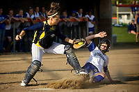 JEROME A. POLLOS/Press..Coeur d'Alene High's Amanda Brouillard slides under the tag of Meridian catcher Andrea Barker to score the final run of Thursday's opening game for the Vikings in the State 5A tournament in Post Falls. Coeur d'Alene shut-out the Warriors 7-0.