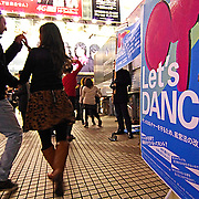 "Volunteers dance to gain support for their petition in front of Shibuya station.  Thursday, December 13, 2012.  (Albert Siegel)  The group ""Let's Dance"" is fighting to change the entertainment business control law which prohibits late-night dancing."