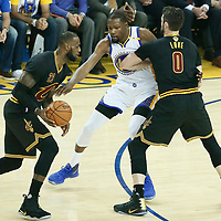 04 June 2017: Cleveland Cavaliers forward LeBron James (23) drives past Golden State Warriors forward Kevin Durant (35) on a screen set by Cleveland Cavaliers forward Kevin Love (0) during the Golden State Warriors 132-113 victory over the Cleveland Cavaliers, in game 2 of the 2017 NBA Finals, at the Oracle Arena, Oakland, California, USA.