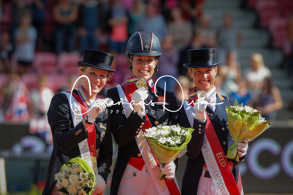 Podium Grand Prix Special<br /> Gold medal : Dujardin Charlotte (GBR)<br /> Silver medal : Langehanenberg Helen (GER)<br /> Bronze medal : Cornelissen Adelinde (NED)<br /> Blue Hors FEI European Championships Dressage - Herning 2013<br /> © Dirk Caremans