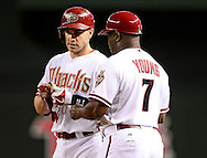 Sep. 14, 2012; Phoenix, AZ, USA; Arizona Diamondbacks catcher Miguel Montero (26) talks with first base base coach XXX during the game against the San Francisco Giants at Chase Field.  Mandatory Credit: Jennifer Stewart-US PRESSWIRE.