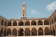 Israel, Acre, The clock tower and walls of the old hostel Khan el Omdan as seen from within the courtyard, June 2006