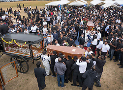 © Licensed to London News Pictures. 04/09/2016. London, UK. Friends and relatives carry the coffins of brothers Kenigan and Kobi Nathan at a joint funeral held at Winn's Common Park for five men who drowned at Camber Sands last month.  The five men: Kurushanth Srithavarajah, brothers  Kenigan and Kobi Nathan, Inthushan Sri and Nitharsan Ravi were all friends from London.  They got into difficulty in the sea of Camber Sands on August 24. Photo credit: Peter Macdiarmid/LNP