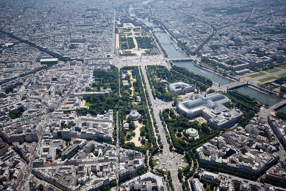 Looking down the Champs-Elysees towards the Tuileries Gardens and the Louvre Museum with the Grande and Petit Palais off to the right on the right bank of the Seine River.