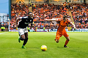 Dundee forward Roarie Deacon (#21) and Dundee United defender Jamie Robson (#17) race towards the ball during the Betfred Scottish Cup match between Dundee and Dundee United at Dens Park, Dundee, Scotland on 9 August 2017. Photo by Craig Doyle.