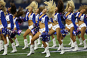 The Dallas Cowboys cheerleaders flip their hair during a dance routine at the NFL week 6 football game against the Washington Redskins on Sunday, Oct. 13, 2013 in Arlington, Texas. The Cowboys won the game 31-16. ©Paul Anthony Spinelli