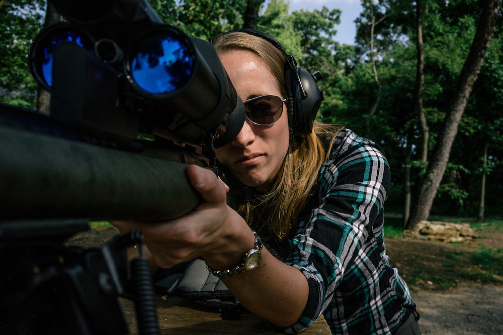 Security researcher Runa Sandvik fires a round from a Tracking Point TP750 rifle at a target 50 yards away as husband and fellow security researcher Michael Auger uses a laptop to hack into the rifle's wifi to change the trajectory of the bullet.