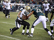 New Orleans Saints running back Darren Sproles (43) tries to elude tackle attempts by Philadelphia Eagles cornerback Cary Williams (26) and Philadelphia Eagles outside linebacker Connor Barwin (98) as he catches a third quarter pass for a gain of 9 yards to the Eagles 8 yard line during the NFL NFC Wild Card football game against the Philadelphia Eagles on Saturday, Jan. 4, 2014 in Philadelphia. The Saints won the game 26-24. ©Paul Anthony Spinelli
