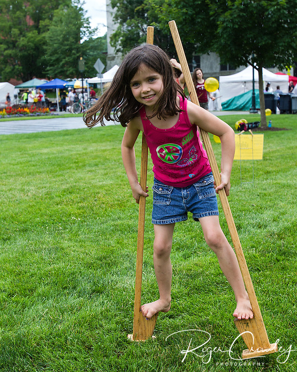 Ava Pryce of East Montpelier walks on stilts on the State House lawn during July 3rd celebration in Montpelier.