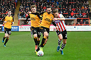 Archie Collins (27) of Exeter City battles for possession with Greg Taylor (5) of Cambridge United during the EFL Sky Bet League 2 match between Exeter City and Cambridge United at St James' Park, Exeter, England on 11 January 2020.
