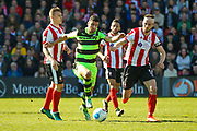 Forest Green Rovers forward Omar Bugiel (11) on a run during the Vanarama National League match between Lincoln City and Forest Green Rovers at Sincil Bank, Lincoln, United Kingdom on 25 March 2017. Photo by Simon Davies.