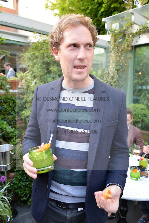 SAM HOARE at a party to celebrate 'A Year In The Garden' celebrating the first year of The Ivy Chelsea Garden, 197 King's Road, London on 16th May 2016.