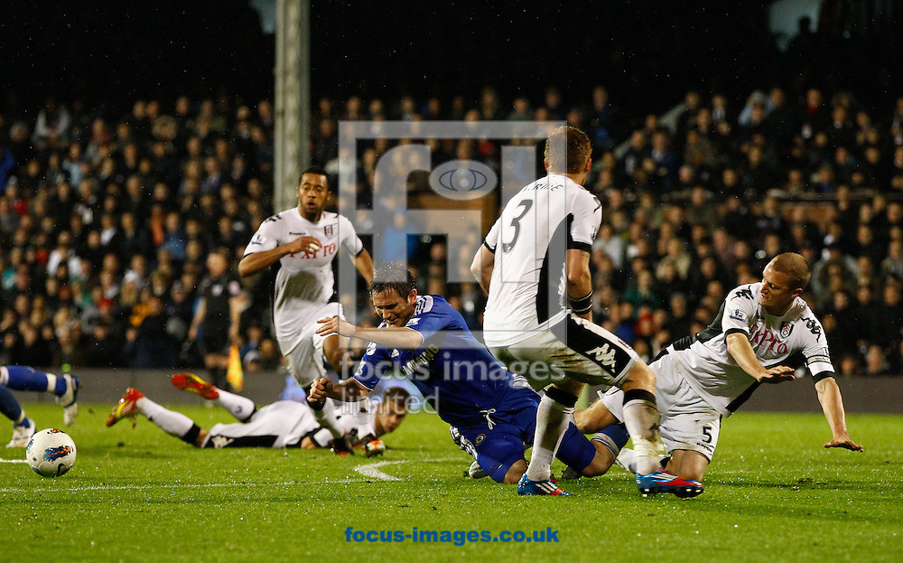Picture by Andrew Tobin/Focus Images Ltd. 07710 761829. 09/04/12 Brede Hangeland of Fulham brings down Frank Lampard of Chelsea during the during the Barclays Premier League match between Fulham and Chelsea at Craven Cottage stadium, London