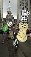 Scott Matthews, holds peanut cutouts, as he protests for human rights, Monday, July 31, 2000, in Philadelphia, on the first day of the Republican National Convention. (Photo by William Thomas Cain/Photojournalist.cc)