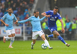September 22, 2018 - Cardiff City, England, United Kingdom - Bernardo Silva of Manchester City and Victor Camarasa of Cardiff City battle for possession during the Premier League match between Cardiff City and Manchester City at Cardiff City Stadium,  Cardiff, England on 22 Sept 2018. (Credit Image: © Action Foto Sport/NurPhoto/ZUMA Press)