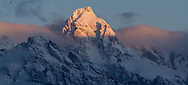 The first light of day hits the summit of the Grand Teton on a frigid winter morning in Grand Teton National Park.