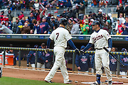 Joe Mauer #7 of the Minnesota Twins is congratulated by Ryan Doumit #9 after scoring against the New York Mets on April 13, 2013 at Target Field in Minneapolis, Minnesota.  The Mets defeated the Twins 4 to 2.  Photo: Ben Krause