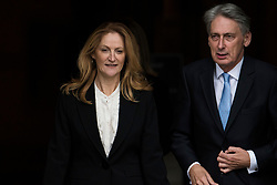 © Licensed to London News Pictures. 04/10/2017. Manchester, UK. Chancellor PHILIP HAMMOND and his wife SUSAN WILLIAMS-WALKER seen on the final day of the Conservative Party Conference. The four day event is expected to focus heavily on Brexit, with the British prime minister hoping to dampen rumours of a leadership challenge. Photo credit: Ben Cawthra/LNP