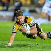 Beauden Barrett  scores during the super rugby union  game between Hurricanes  and Highlanders, played at Westpac Stadium, Wellington, New Zealand on 24 March 2018.  Hurricanes won 29-12.