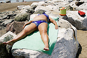 ITALY, Liguria, Zoagli.<br /> <br /> ITALY, Liguria, Zoagli.relaxing on the rocks