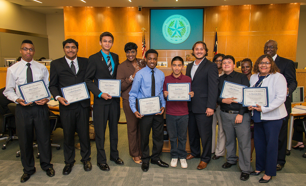 Houston ISD Interim Superintendent Ken Huewitt and trustee Wanda Adams pose for a photograph with members of the Madison High School Sensation Station Rocket Club during a meeting of the Board of Trustees, June 9, 2016.