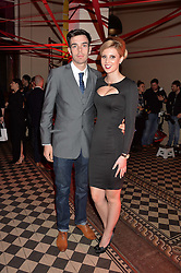 Professional cyclist ANDY TENNANT and LAUREN BASON at the Tunnel of Love art and fashion auction and dinner in aid of the British Heart Foundation held at One Mayfair, London on 12th November 2013.