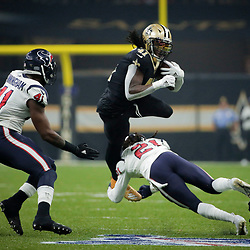 Sep 9, 2019; New Orleans, LA, USA; New Orleans Saints running back Alvin Kamara (41) is upended by Houston Texans cornerback Bradley Roby (21) during the first quarter at the Mercedes-Benz Superdome. Mandatory Credit: Derick E. Hingle-USA TODAY Sports