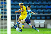 Lyle Taylor (33) of AFC Wimbledon crosses the ball under pressure from Jack Williams (11) of Wycombe Wanderers during the Pre-Season Friendly match between Wycombe Wanderers and AFC Wimbledon at Adams Park, High Wycombe, England on 25 July 2017. Photo by Graham Hunt.