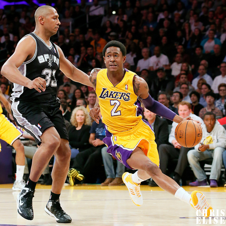 19 March 2014: Los Angeles Lakers guard MarShon Brooks (2) drives past San Antonio Spurs forward Boris Diaw (33) during the San Antonio Spurs 125-109 victory over the Los Angeles Lakers at the Staples Center, Los Angeles, California, USA.