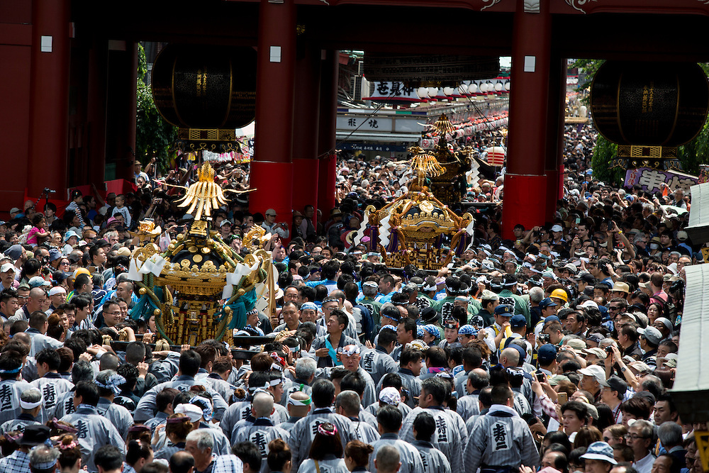 TOKYO, JAPAN - MAY 14: The residents of Asakusa band together to carry a 'mikoshi' shrines while they chant together in front of in Senso-ji Temple in Asakusa, Tokyo on May 14, 2016. These mikoshi (portable shrine) is carried in the streets of Asakusa to bring luck, blessings and prosperity to the area and its inhabitants.<br /> <br /> Photo: Richard Atrero de Guzman