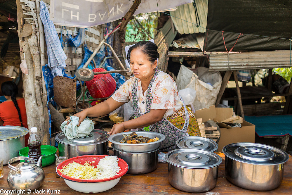 05 MARCH 2014 - MAE SOT, TAK, THAILAND: A noodle vendor at the Mae Tao Clinic in Mae Sot. The Mae Tao Clinic provides  healthcare to over 150,000 displaced Burmese per year and is the leading healthcare provider for Burmese along the Thai-Myanmar border. Reforms in Myanmar have alllowed NGOs to operate in Myanmar, as a result many NGOs are shifting resources to operations to Myanmar, leaving Burmese migrants and refugees in Thailand vulnerable.     PHOTO BY JACK KURTZ