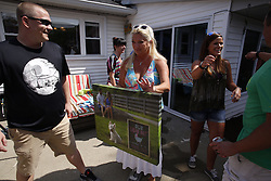 Jennifer and Kevin Geerts announce they are pregnant at a cookout at Bonnie Helwig's, Sunday, Sept. 04, 2016 at Helwig Crib in Louisville.