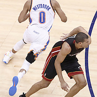 14 June 2012: Oklahoma City Thunder point guard Russell Westbrook (0) drives past Miami Heat small forward Shane Battier (31) during the Miami Heat 100-96 victory over the Oklahoma City Thunder, in Game 2 of the 2012 NBA Finals, at the Chesapeake Energy Arena, Oklahoma City, Oklahoma, USA.