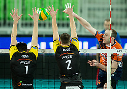 Srecko Lisinac of PGE Skra Belchatow, Mariusz Wlazly of PGE Skra Belchatow vs Ziga Stern of ACH during volleyball match between ACH Volley (SLO) and PGE Skra Belchatow (POL) in Round #4 of 2017 CEV Volleyball Champions League, on January 19, 2017 in Arena Stozice, Ljubljana, Slovenia. Photo by Vid Ponikvar / Sportida