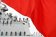 View of Shenzhen docking at Harumi Pier in Tokyo.<br /> <br /> This is the Chinese warship Shenzhen, a missile destroyer that arrived Japan on Nov. 28, 2007, docking at Tokyo's Harumi Pier. This was the first time in the post World War II era that a Chinese warship ever visited Japan. I was also the first time the China's People's Liberation Army ever visited Japan. A similar visit was scheduled for May 2002 but was canceled due to then Japanese Prime Minister Junichiro Koizumi visiting Tokyo's controversial Yasukuni Shrine where 14 WW II Class A war criminals are enshrined. But now that Japan's new Prime Minister Yasuo Fukuda has vowed to not visit the shrine while in office, relations seem to be improving between the two countries. Even so, Japan is still concerned about China's military buildup which China says is for peaceful purposes. The Shenzhen was escorted into port by a Japanese destroyer and was greeted by Admiral Eiji Yoshikawa, the chief of staff for Japan's Maritime Self Defense Force (MSDF). Yoshikawa welcomed Rear Admiral Xiao Xinnian, the commander of the destroyer, as well as a crowd of Chinese well wishers bused in by the Chinese consulate. During the Shenzhen's four day stay in Japan the ship will be open to the public, while its crew of 345 will visit Japanese naval bases, military academies, and participate in sporting events. Officers will also pay visits to Japan's Defense and Foreign Ministries. The home base of the Shenzhen is the southern Chinese port of Zhanjiang. A reciprocal visit by the Japanese MSDF is in the works for an unannounced date.