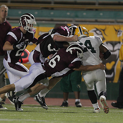 31 October, 2008:  St. Thomas Aquinas LB/WB Charles Robert Miller  (#16) St. Thomas Aquinas FS/RB Travis Gregory (#32) St. Thomas Aquinas DB/WR Russell Pellichino  (#21) The St. Thomas Falcons recorded their first shut out of the season with a 41-0 shutout of the Southern Lab Kittens at Strawberry Stadium in Hammond, LA.