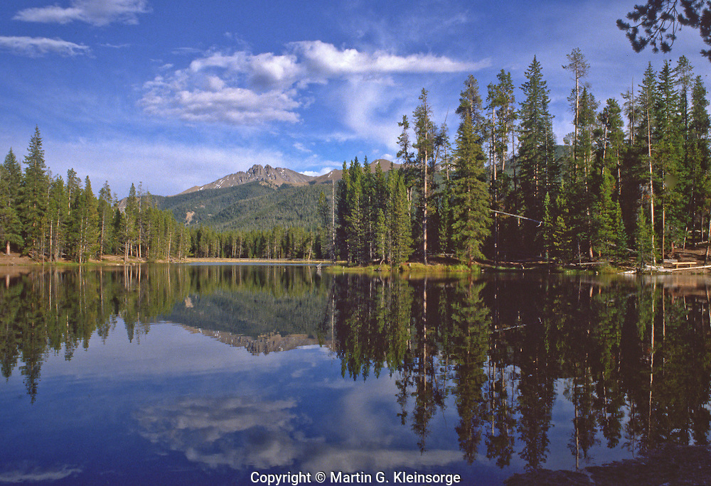 Reflections of Nakhu Crags in Ranger Lakes, Colorado State Forest State Park, Colorado.